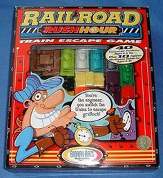 Railroad Rush Hour -- version of the famous Rush Hour puzzle with some pieces moving in four directions. In addition to Scott Kim's challenges, some challenges have been created by Serhiy Grabarchuk; manufactured by Binary Arts Corp. / ThinkFun, Inc.; released in 1999.