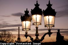 Illuminated Lamppost in Place de la Concorde Square in the Eiffel Tower in the background in Paris, France from www.kevingeorge.photoshelter.com