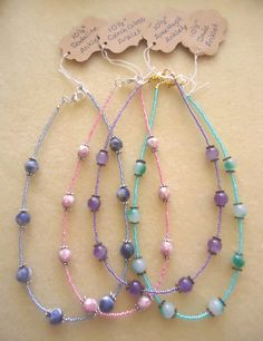 Perfect for Easter!  These anklets were made with a matching design and complementary color schemes, including: purple with amethyst, pink with Czech glass, sky blue with sodalite and sea green with jade.  Enjoy :)