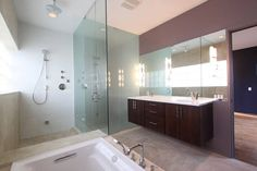 Need more space in your bathroom? Check out this design! #bathroom #renovation #remodeling #home #bath #shower #glass #cleandesign