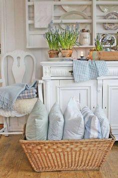 I LOVE the idea of a basket of pillows in the family room. Instant comfort.