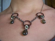 hand forged copper,leather bails,sterling silver and gemstones