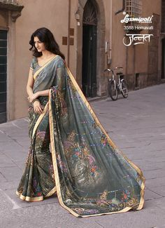Dazzle like million stars on your special days with our Georgette Camouflage Green coloured Striped and Floral Printed Saree. It has been further Glorified by the raw silk lace on its border. It is having Beetle Green coloured Pashmina Blouse. www.laxmipati.com