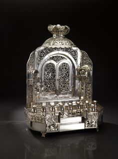 Chains of Silver-An Elegant Hanukka Menora Modeled as a Synagogue Wall