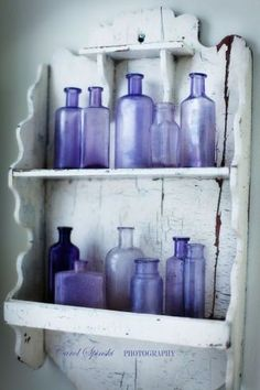 lavender coloured vintage bottles on old shelf, I want this done in my bathroom. . any one know where i can get some old bottles?