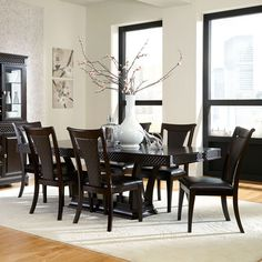 The Sonoma dining table is a glamorous mix of elegant and versatile, loaded with special features from top to bottom. The Sonoma's balance of clean lines, subtle shaping and textured details create a unique look that's suitable for any type of decor. The embossed diamond textures create a visual interest as well as performing double duty with hidden storage for silverware. Quality features such as dovetailed drawers and ball-bearing drawer glides are complimented with a deep walnut finish…