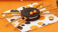 Ingredients  double stuffed  oreos pretzel sticks chocolate frosting small round candies