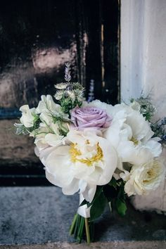 Beautiful bouquet inspiration with hints of color and greenery. ---> http://www.weddingchicks.com/2014/05/31/take-a-letter/