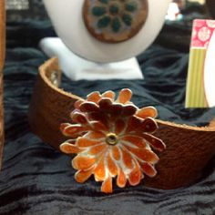 Leather bracelet with anodized aluminum (see the board Making of anodized aluminum).  The top flower spins!!!