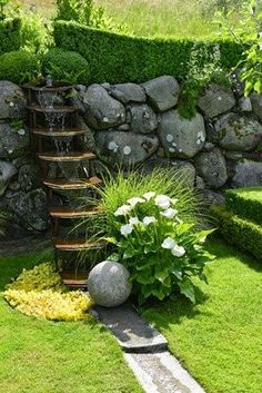 Lovely Scandinavian garden with a spectacular, unusual water feature - photo via clausdalby.dk