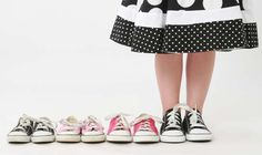 This would be a neat photo if you saved one pair of shoes each year and lined them up smallest to current size on the kid's feet.  Might be a fun way to show how they're growing.