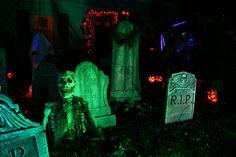 Graveyard.....break glow sticks and drip them onto the grave stones halloween night!
