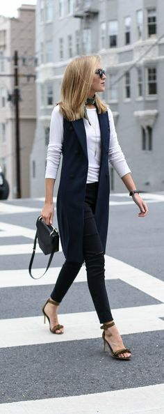 This navy double-breasted vest and olive fringe sandals paired with ripped skinny jeans and a simple white tee is the perfect Casual Friday look. Black Vest Outfit, Vest Outfits, Casual Outfits, Fashion Outfits, Sleeveless Blazer Outfit, Long Vest Sleeveless, Formal Outfits, Long Black Vest, Black Pants