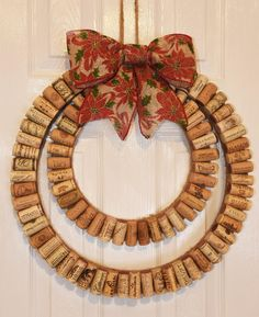 The Modern Wine Cork Wreath with Rustic Christmas Bow by uncorKed by Kimberly is the perfect Christmas home decor for every wine lover! The wreath is handmade using recycled wine corks from various vineyards. In the images shown, red and white wine c Wine Craft, Wine Cork Crafts, Wine Bottle Crafts, Wine Bottles, Christmas Bows, Rustic Christmas, Christmas Crafts, Christmas Decorations, Wine Cork Wreath
