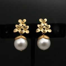 Items similar to Swarovski white round pearl with gold flower post earrings- Free US shipping on Etsy