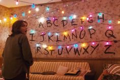 """The famous wall of lights from Stranger Things, used to communicate with """"the other side"""", is one of the most iconic parts of the Netflix series. The Best Costume This Halloween Is Going To Be The Wall From """"Stranger Things"""" Stranger Things Alphabet Wall, Stranger Things Gifts, Stranger Things Aesthetic, Stranger Things Season, Stranger Things Netflix, Stranger Things Christmas Lights, Stranger Things Halloween Decorations, Joyce Stranger Things, Letras Stranger Things"""