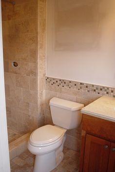Tile backsplash where it meet the shower.