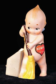 Antique Kewpie with Broom and Dustbin, c. 1915. By Denise Van Patten.