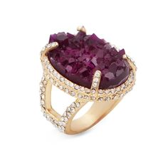 Get done up in druzy with the Norah Ring. You'll be nothing short of regal in the warm tones of gold and amethyst. Norah's stunning prong-set druzy stone is emblazoned in CZ's for even more bling. Find it on Splendor Designs