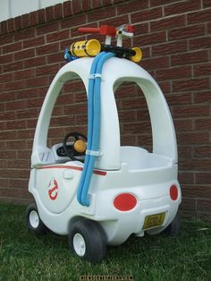 Woodworking For Kids Ghostbusters cozy coupe makeover. So adorable. Little Tikes Makeover, Cozy Coupe Makeover, The Ghostbusters, Little Tykes, Woodworking For Kids, Woodworking Projects, Ghost Busters, Kids Ride On, Batmobile