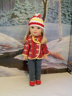 This listing is for a jacket, jeans and hat for your Wellie Wisher doll. This set is View 1 of my next sewing pattern for 14 dolls called A Wellie Cold Winter. Buyers of the pattern will see this set come together in pictures.  The jacket is made from double sided quilted cotton so it is self lined with a contrasting print. It has a unique asymmetrical shape; the flap has been tacked down and adorned with a dark blue button. The hat is made from white ribbed knit and is adorned with two rows…