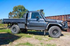 Right side view of a Grey 79 Series Single Cab Toyota Landcruiser at Superior Engineering fitted out with a new rear coil conversion kit and front suspension parts Toyota Trucks, Lifted Ford Trucks, Jeep Truck, Landcruiser Ute, Landcruiser 80 Series, My Dream Car, Dream Cars, Dream Life, Pick Up