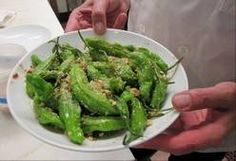 Shishito peppers are small, thin Japanese peppers that resemble jalapenos but generally taste sweeter than they do hot. Try them grilled or seared. Here's a recipe for Grilled Shishito Peppers.