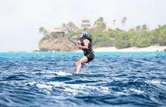 Former U.S. President Barack Obama tries his hand at kite surfing during a holiday with British businessman Richard Branson on his island Moskito, in the British Virgin Islands, in a picture handed out by Virgin on February 7th, 2017.