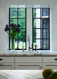 A Kitchen Look We Love: Black + Marble In this kitchen from Traditional Home (via Savor Home), marble gets punched up with just a bit of black, in the window frame. Bonus points for the way the subway tile wraps into the deep window opening. That's a nice detail.