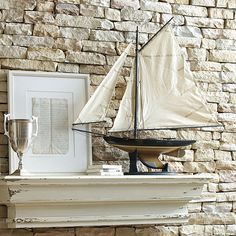 If you know someone who loves boats or sailing, it's the perfect fair weather gift. This '30s style sailboat model is hand built plank-on-frame. Hull comes fully assembled in walnut finished wood and fitted with brass antique hardware. We saved the fun part for you, rigging the tea-stained cotton sails.