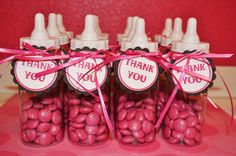 thank you gifts but with blue/brown/red ribbon and candy