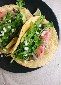Fresh arugula and black bean tacos with pickled radish and feta | Food | The Lifestyle Edit