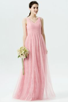3253e229009 Sleeveless candy pink long bridesmaid dress comes with tulle overlay and  floral lining. It features a crisscross pleated tulle empire waist bodice.