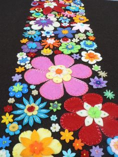Embroidered and appliqued felt flowers - really pops with the black backround - would make a cute table runner.