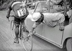 Italian cyclist Gino Sciardis getting his bike lubricated during the 1949 Tour de France