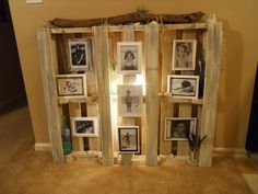 Re-purposed wood pallet...painted, added seashell, driftwood, bottles, photos of my kids...