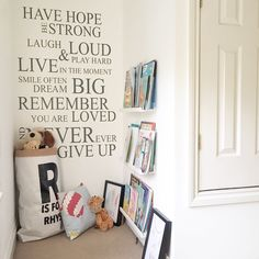 Super cute reading nook or snug in a corner of a children's room  Love the use of the Ikea picture ledges as book shelves