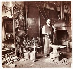 Blacksmith in a foundry c 1905. by Sutcliffe