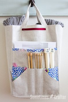 A great knitting project bag to hold all of your tools! Keep straight, double pointed and circular needles organized in one place with pockets perfect for all sizes. A small zipper pocket is a grea…