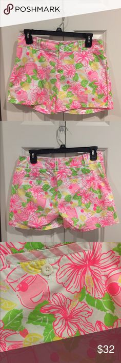Lilly Pulitzer Umbrella Drink Shorts These shorts are in like new condition. They have a fun print with daiquiri drinks on them. They also have some pink striped trim on the top and belt loops too. Lilly Pulitzer Shorts