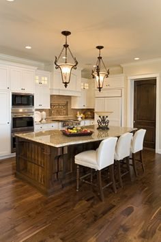 Those chairs with nailhead trim for a mix of classy/girly with a large reclaimed wood island. Makes my heart happy! I don't like the lights here, would change the pantry door to include windows and a wreath :) lol and want a sparkly tile backsplash