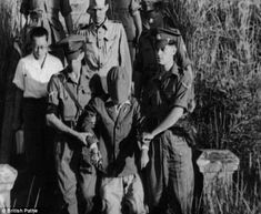 Led to his death: British officers and soldiers escorting General Shampei of the Japanese Army to his execution post. Shampei was charged with crimes of murdering Australian prisoners of war. The firing squad were volunteers of the Northamptonshire Regiment