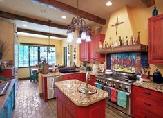 Eclectic kitchen with red cabinets and yellow walls. Southwest Kitchen, Mediterranean Kitchen, Eclectic Kitchen, Red Kitchen, Kitchen Colors, Happy Kitchen, Kitchen Ideas, Kitchen Photos, Mediterranean Style