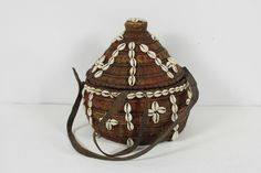 Handcrafted Ethnic Basketry Coiled Leather Straps Cowrie Shell Basket