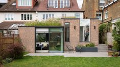 Fraher & Findlay has built a wildflower-topped rear extension, a glass-walled courtyard and a loft extension for a house in London. Smooth Concrete, Rear Extension, Extension Ideas, Small Tiny House, Small Modern Home, Brick Architecture, Modern House Plans, Modern Houses, Tiny Houses