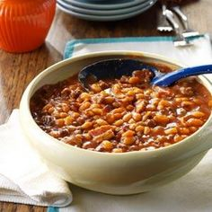 Fourth of July Baked Beans Recipe with ground beef, onions, sugar, brown sugar, ketchup, barbecue sauce, yellow mustard, molasses, chili powder, beans, bacon slices
