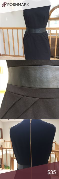 Calvin Klein Black Dress  Size 4 Beautiful Black Calvin Klein dress Size 4. Sleeveless with leather like trim at waist. Dress has some stretch to it. Gold zipper up back. Knee length. Could easily go from work to out on the town! Calvin Klein Dresses Midi