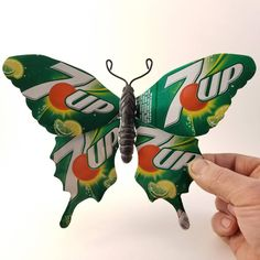 Butterfly wings are made of recycled aluminum cans. The edges are not sharp. The body is black resin. A magnet on the back allows it to be hung on a magnetic surface. There is also a hole in the back so that it can be hung on a small nail. Aluminum Can Crafts, Aluminum Cans, Metal Crafts, Recycled Art Projects, Upcycled Crafts, Crafts From Recycled Materials, Recycling Projects, Recycled Furniture, Coke Can Crafts