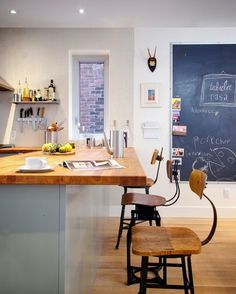 contemporary kitchen by Andrew Snow Photography - love stuffing photos in the chalkboard frame