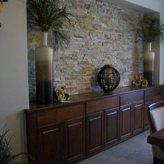 Entry wall light rock, lights on top Dining Room Buffet. love the stone wall accent Dining Room Buffet, Dining Room Walls, Dining Room Design, Living Room Decor, Stone Wall Living Room, Stone Accent Walls, Faux Stone Walls, Home Interior Design, Interior Paint